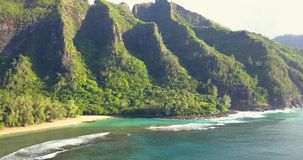 Aerial View of Kauai Beach in Hawaii. Amazing aerial view of the Hawaii nature, beac, Pacific ocean waves during sunset time. View on the beach at the Kauai stock video footage
