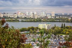 Aerial view of the Kiev city from an observation point over the Dnieper river with railway bridge yachts at the berth and new resi Royalty Free Stock Photography
