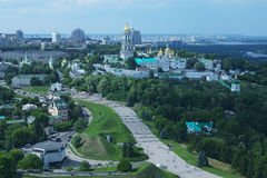 Aerial view of Kiev Pechersk Lavra, the city buildings, Dnieper River and private houses from Monumental statue Mother Motherland.  Royalty Free Stock Photo