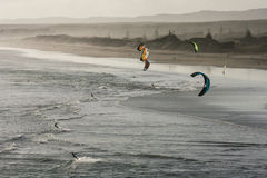 Aerial view of kite surfers on Muriwai beach Stock Images