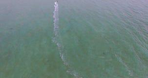 Aerial view kite surfing in tropical blue ocean 4K stock footage