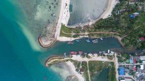 Aerial view of Koh Phangan fisherman marina. Clear blue sea from aerial view of Koh Phangan pier Royalty Free Stock Images