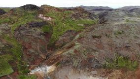 Aerial view of Krysuvik geothermal hot springs and steam vents, Reykjanes peninsula, Iceland. Beautiful and colorful Krýsuvík Geothermal Area with mud pots stock footage