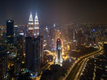 Aerial view of Kuala Lumpur Downtown and highways, Malaysia. Financial district and business centers in smart urban city in Asia. Skyscraper and high-rise stock photo