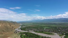 Aerial view on the Kura river and Caucasus mountains. From Ancient cave city Uplistsikhe, Georgia stock video footage