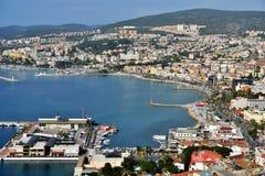 Aerial view of Kusadasi, Turkey. Kusadadi, Turkey - April 7, 2014: Aerial view to the bay and cityscape. Many cruise liners visit Kusadasi Port and most of Stock Photo