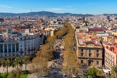 Aerial view of La Rambla street in Barcelona, Catalonia, Spain. Aerial view over La Rambla street from Christopher Columbus monument, with quarters of El Raval royalty free stock images