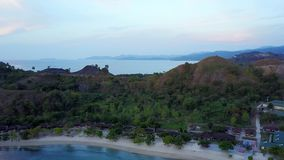Aerial view of Labuan Bajo resort. Exotic aerial view of Labuan Bajo resort with turquoise water, white sand, and smooth wave in Flores Island, an island close stock video footage
