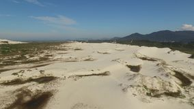 Aerial view Lagoa da Conceicao and dunes in Florianopolis - Santa Catarina - Brazil. July, 2017 stock footage