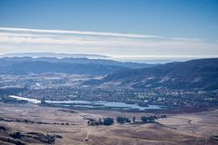 Aerial view of Laguna Lake, San Luis Obispo, California; the Pacific ocean coastline covered by a layer of fog in the background royalty free stock photos