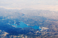 Aerial view of lake Arrowhead in California, the USA. Blue pond is in the mountain forests of San Bernardino County Stock Image