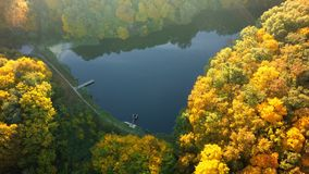 Aerial view on the lake and autumn forest.  royalty free stock photo