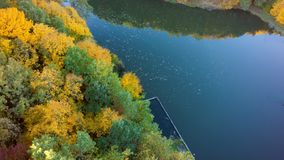 Aerial view on the lake and autumn tree forest.  royalty free stock photo