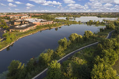 Lake and Community Center Aerial. Aerial view of a lake bee a community center with walking paths and bridge in The Glen, Glenview, Illinois Stock Photo