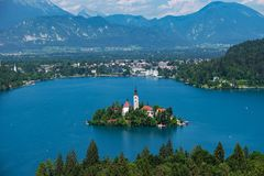 Aerial view of Lake Bled, Alps, Slovenia, Europe. Mountain alpine lake. Island with church in Lake Bled. Summer landscape. Castle and mountains in background royalty free stock images