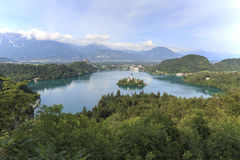 Aerial view of lake Bled at sunset with a view of the island church and the castle Royalty Free Stock Image