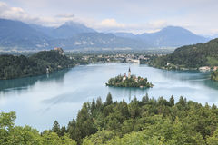 Aerial view of lake Bled at sunset with a view of the island church and the castle. Royalty Free Stock Photo