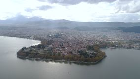 Aerial view of lake and city Ioannina Greece stock video footage