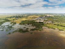 Aerial view on lake Corrib, county Galway, Ireland. Rural landscape. Cloudy sky. Green fields and old abandoned quarry