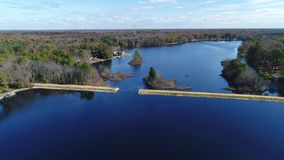 Aerial View of Lake and Dam stock footage