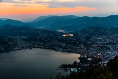 Aerial view of the lake Lugano surrounded by mountains and evening city Lugano on during dramatic sunset, Switzerland, Alps. Travel Royalty Free Stock Photos