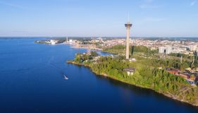 Aerial view from the lake. Observation tower and amusement park on the shore. stock images