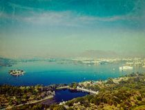Aerial view of Lake Pichola, Udaipur, Rajasthan, India. Vintage retro hipster style travel image of aerial view of Lake Pichola with Lake Palace (Jag Niwas) and Stock Photography