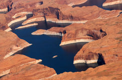 Aerial View of Lake Powell. An aerial view of Lake Powell, a popular vacation destination. Here you can see the red rock that Lake Powell is famous for Royalty Free Stock Image