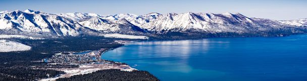 Aerial view of Lake Tahoe on a sunny winter day, Sierra mountains covered in snow visible in the background, California stock photography