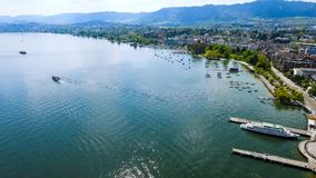 Aerial View Of Lake Zurich In Switzerland. Aerial View Of Lake Zurich City feat Seafront Lakeside on a Sunny Day In Switzerland Europe Stock Photo