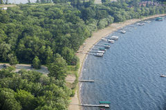 Aerial view of lakeshore with docks and boats in Minnesota. Aerial view of typical lakeshore with docks and boats in Minnesota Stock Photography