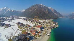 Aerial view of lakeside hotel at mountain bottom, nature, tourism, recreation. Stock footage stock video