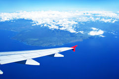 Aerial view of land and the ocean from airplane Royalty Free Stock Images