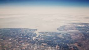 Aerial  view - land and sea. Land and sea view from airplane Stock Photo