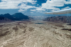 Aerial view of landscape around Nazca town, Peru. Aerial view of sandy landscape around Nazca town, Peru royalty free stock photos