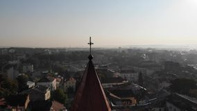 Aerial view of Landscape of Drohobych city. Smooth pan around dome of medieval Bell Tower of St.Bartholomew church with stock video