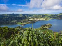 Aerial view of landscape with green and blue crater lakes of Lagoa Azul and Lagoa Verde and Sete Cidades village in the stock photo