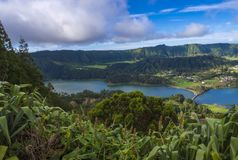 Aerial view of landscape with green and blue crater lakes of Lagoa Azul and Lagoa Verde and Sete Cidades village in the stock image
