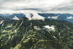Aerial view of landscape with green plains on Kamchatka peninsula, Russia royalty free stock photo