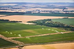 Aerial view of a landscape with irrigated field. stock image