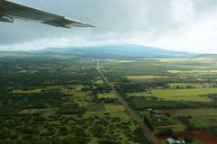 Aerial view of the landscape of Molokai, with a wing. Aerial view of the landscape of the island of Molokai in Hawaii, showing the wing of a small airplane Royalty Free Stock Photography