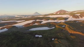 Aerial View. Landscape mountains. Flying grass and snow in the mountains stock video
