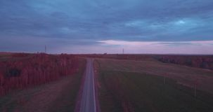 Aerial view of landscape with a ride on the highway trucks and a few cars at sunset and clouds. 4K. Aerial view of landscape with a ride on the highway trucks stock video