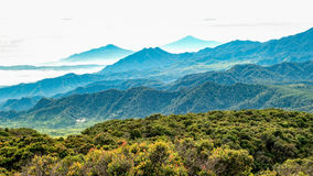 Aerial view of large area of forest, followed by misty hill and. Mountain, beautifully layered, seen from Tangkuban Perahu Summit, Subang, Indonesia Stock Photography