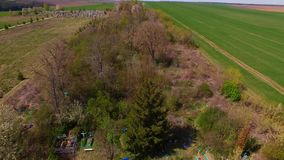 Aerial view of a large cemetery surrounded by trees stock video