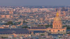 Aerial view of a large city skyline at sunset timelapse. Top view from the Eiffel tower. Paris, France. stock footage