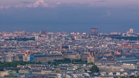 Aerial view of a large city skyline at sunset timelapse. Top view from the Eiffel tower. Paris, France. stock video