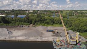 River crane excavator on barge. Aerial view large crane an excavator mounted on barge. Excavator on river for unloading and loading sand and rubble stock video footage