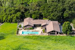 Aerial view of large house with pool surrounded by trees and green meadows, San Jose, Santa Clara county, south San Francisco bay stock photography