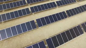 Aerial view large industrial Solar Energy Farm producing concentrated solar energy stock video footage